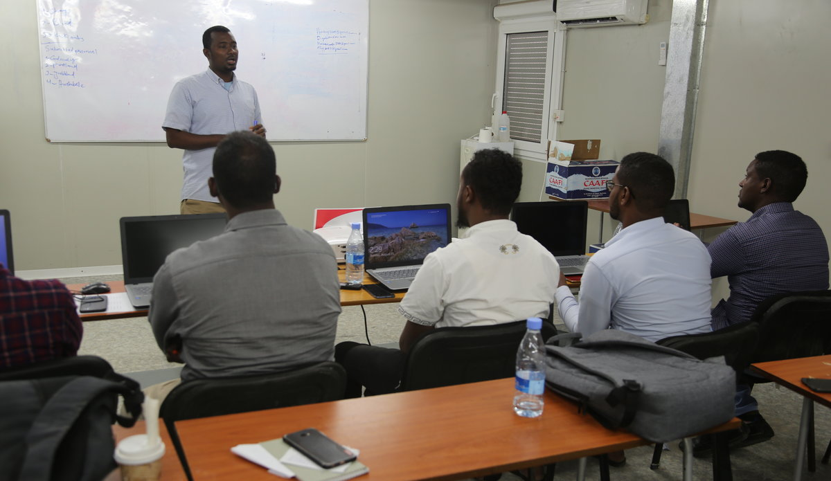 New Community based Liaison Officers receiving training on how to deliver risk education before deployment to the field.